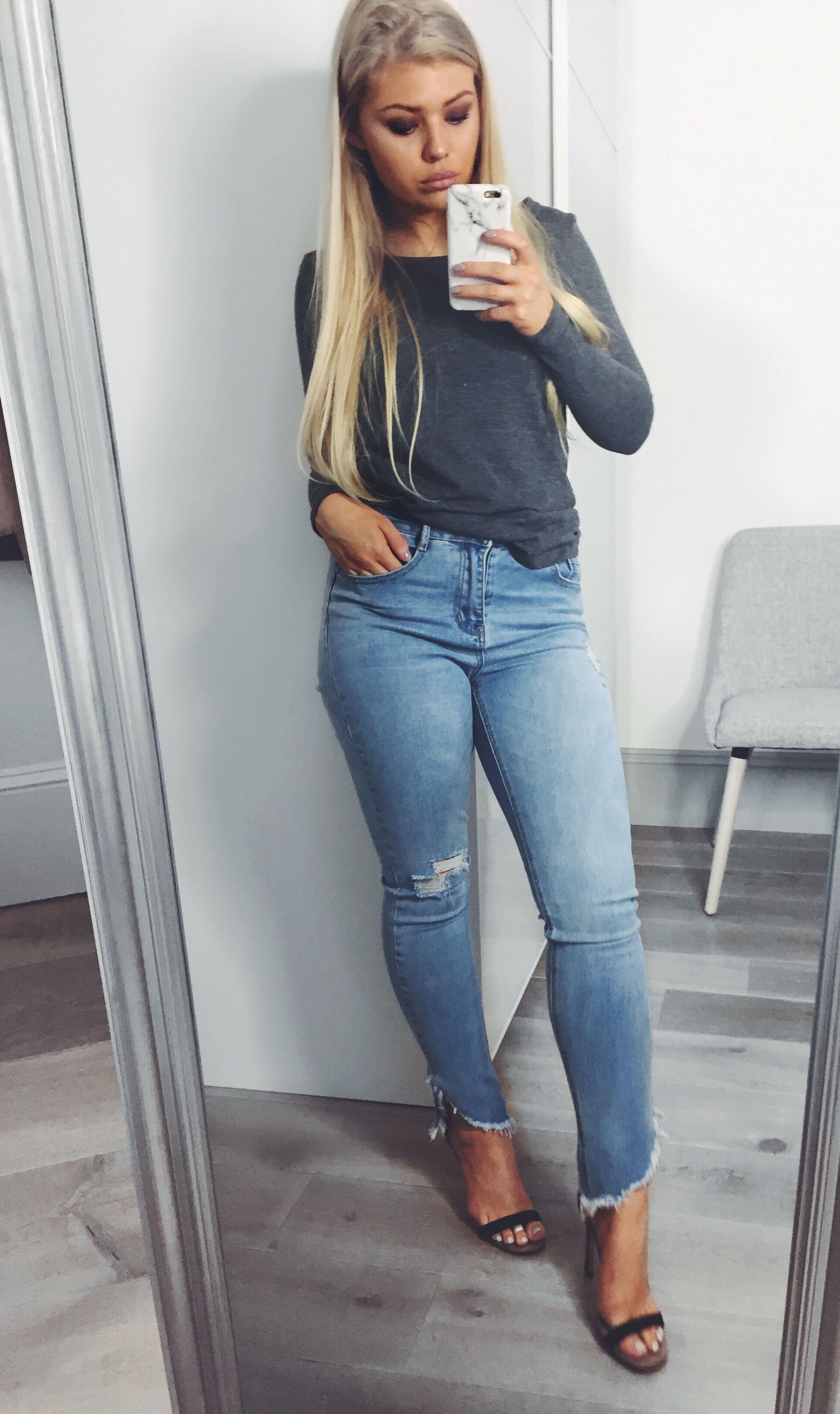 798e5ebb3f Skinny blue jeans with distressed hem