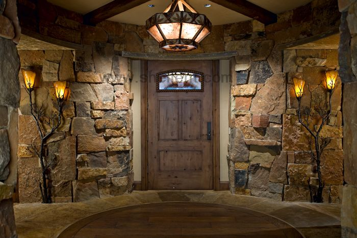 Rough cut stone with a knotty alder wood door. Perfect combination!