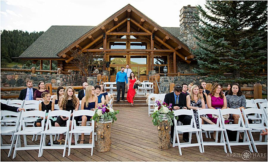 Outdoor fall wedding ceremony on wood deck of Evergreen Lake House ...