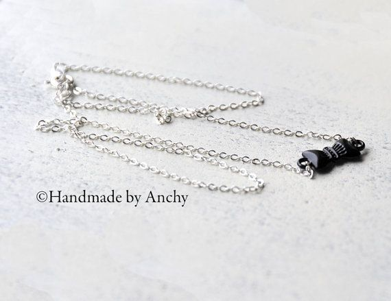 Black bow on silver colored necklace by Anchy on Etsy