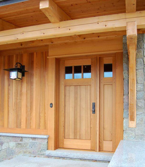 The Design Of A Custom Cedar Door With A Single Sidelight Mimics The Exterior Cedar Paneling On A Lake Home D20 Garage Door Design Cedar Door Cedar Paneling