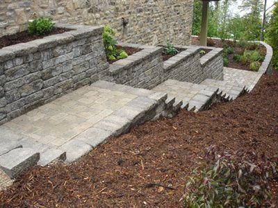 The Weathered Mosaic Wall And Paver Stairs Framed By VERSA LOK Caps Complemen