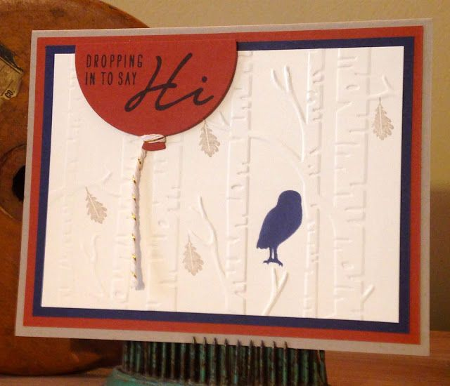 "Cajun Craze and Night of Navy look bold on a white background on this handmade ""hello"" card. Use the Woodland Textures embossing folder for added dimension."