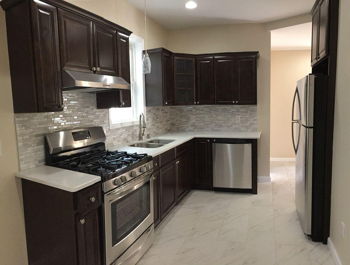Kitchen cabinets . Espresso with white quarts | Kitchen ...