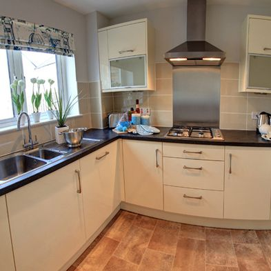 The High School - large open plan kitchen with integrated appliances. http://ogilviehomes.co.uk/