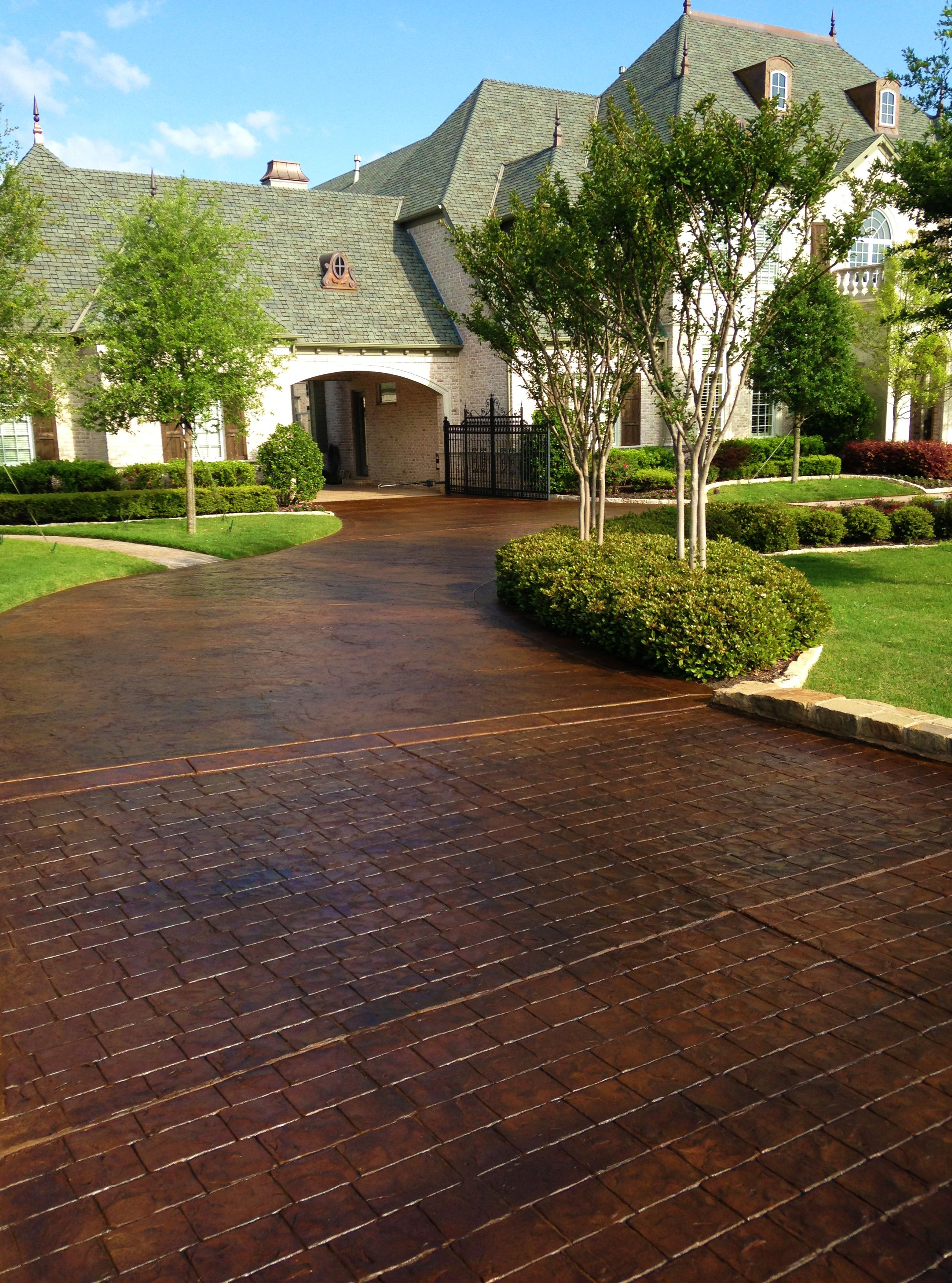 Stained and stamped driveways can give your home classic beauty that never goes out of style Home driveway design ideas