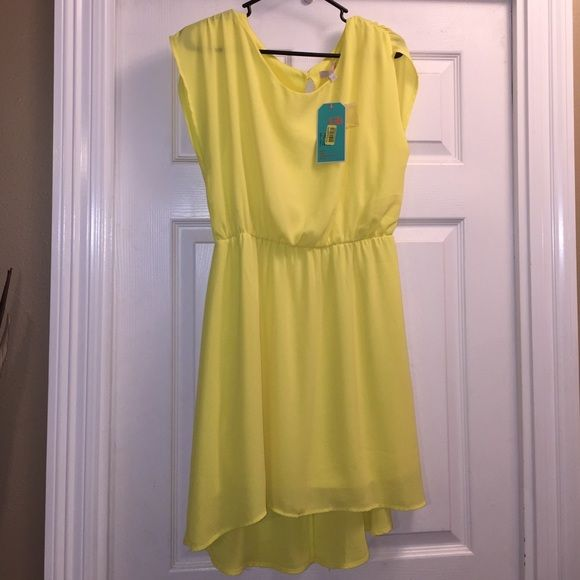 Dress Very cute spring/summerish yellow dress . Brand new never been worn ! NWT Gianni Bini Dresses High Low
