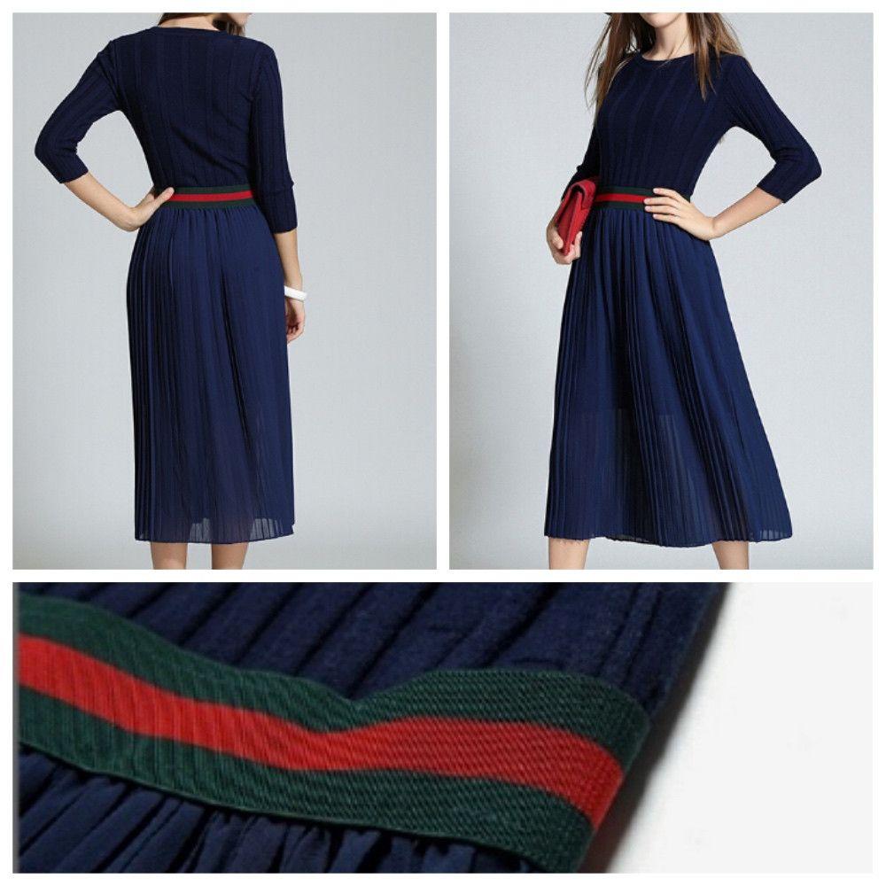 Midi-length blue a-line sweater dress.