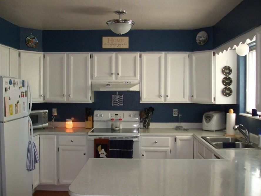 Kitchen Design Dark Blue Wall Paint Color For G Shaped Kitchen With White Cabinet And Double Bowl S Blue Kitchen Walls Kitchen Cabinet Colors Kitchen Interior
