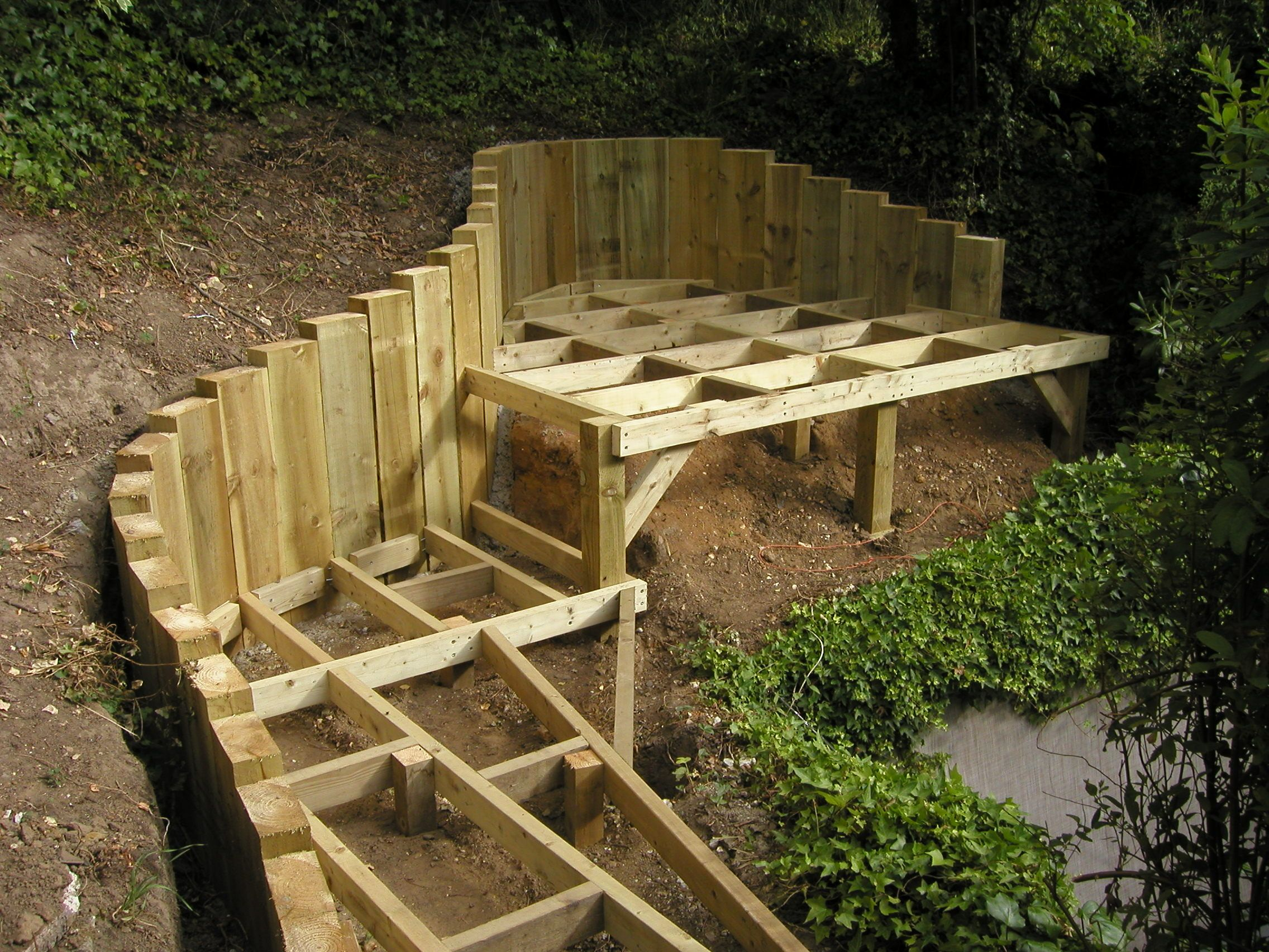 A good way to bridge to the hill landscaping pinterest for Garden decking sleepers