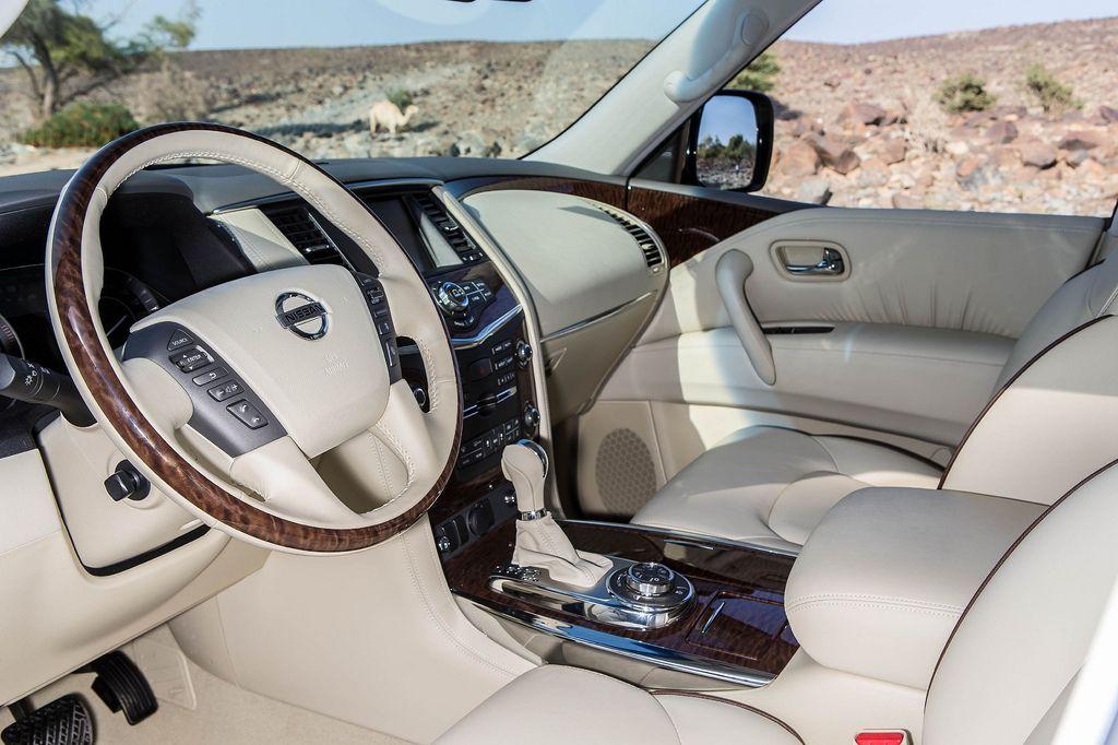 2014 Nissan Patrol vs 2014 Infiniti QX80 interior front side