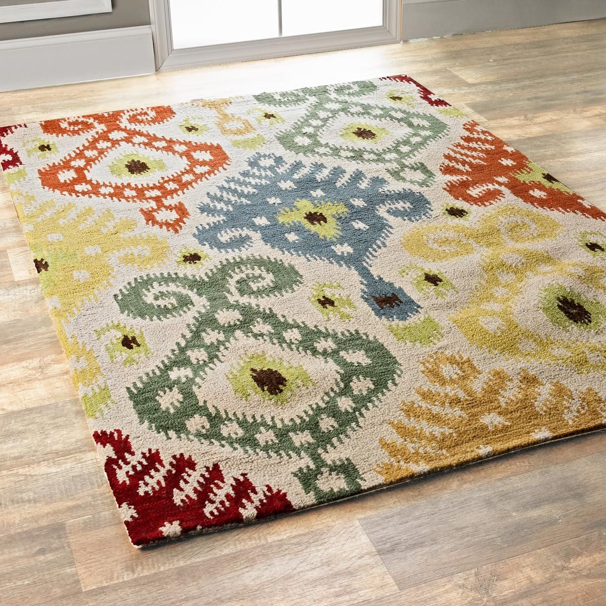 Pop Colors Ikat Rug In a chunky hand hooked construction, this ...