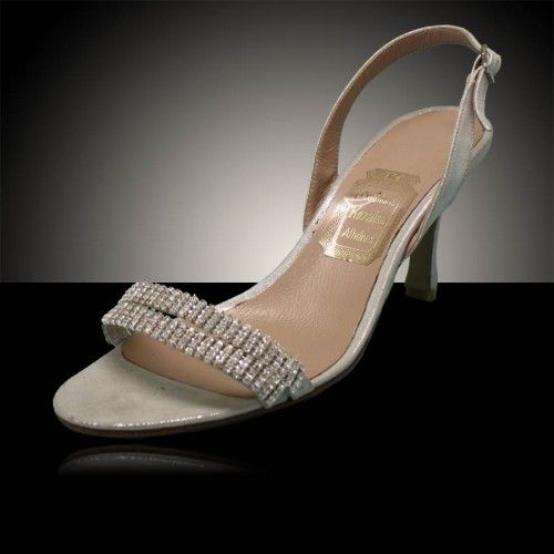 Betsy - A fine sandal consisting of two thin straps decorated with strass lines. It is made from soft leather pressed with a fine silver film which adds a discrete glitter
