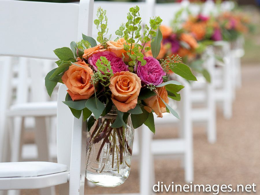 Bright and colorful ceremony aisle flowers from Enchanted Florist at Legacy Farms, photo by Divine Images