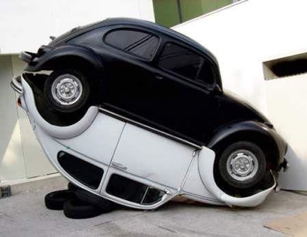 A cool modern Yin Yang Cars Art inspired sculpture made of VW bugs