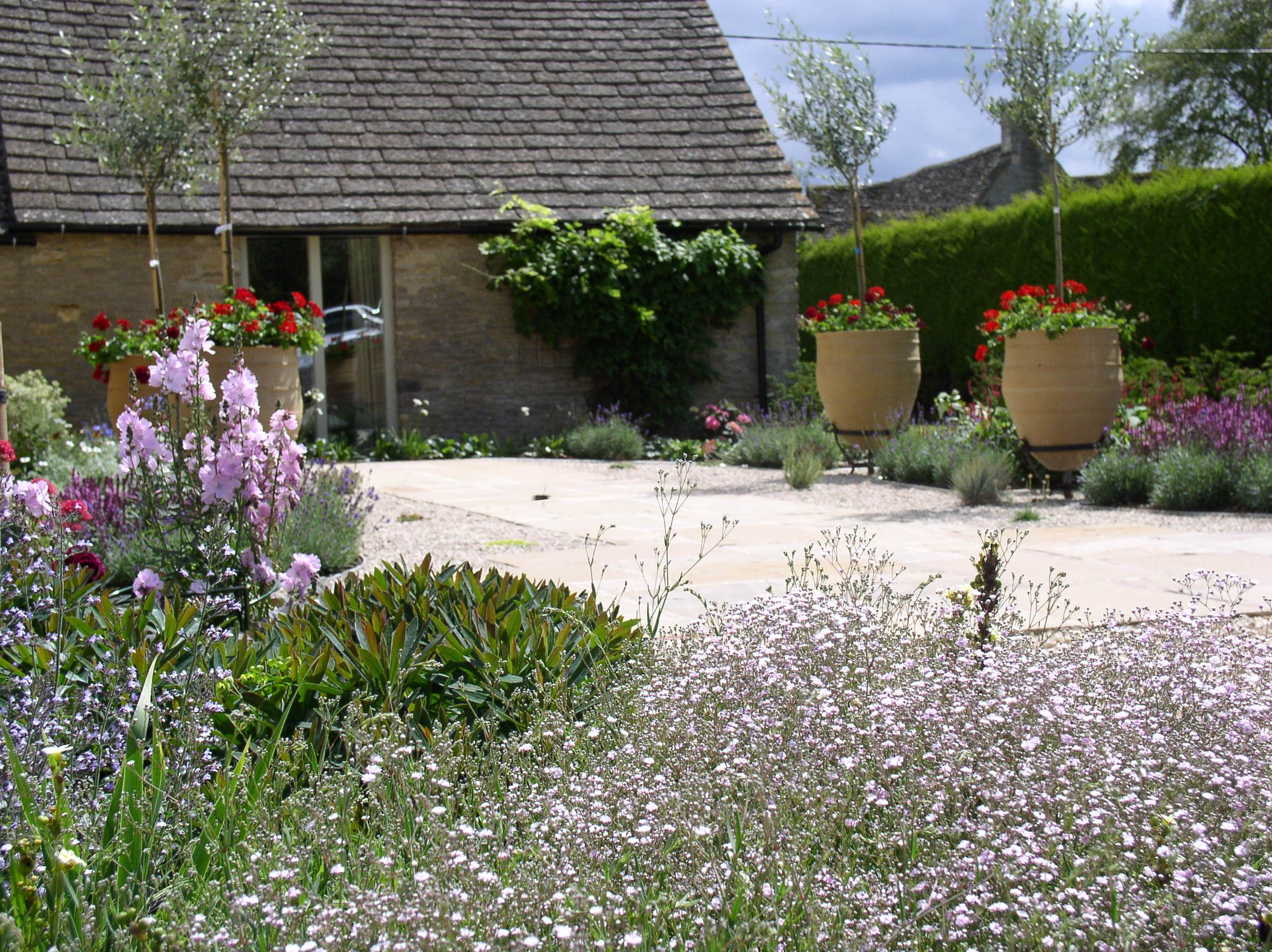 Country Garden Design In Gloucestershire First Summer After Autumn Planting A Bit Of Medi Mediterranean Garden Design Country Garden Design Country Gardening