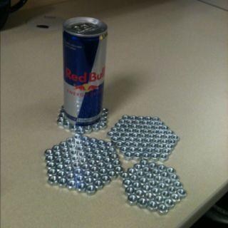 Posa-vasos hexagonal con tuercas