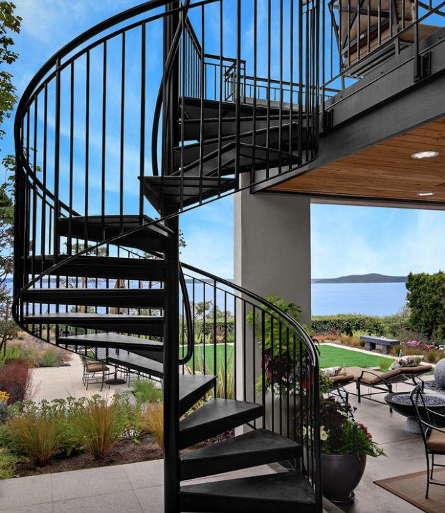 Spiral Staircase Leading To A Rooftop Terrace