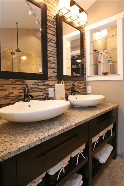 A travertine and glass tile accent wall Epic Bathroom Revamp