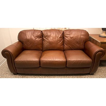 Lane Leather Master Sofa With Fluffy Rounded Back Cushions Detached Seat And Rolled Arms Upholstered In Quality Caramel Brown Pebble