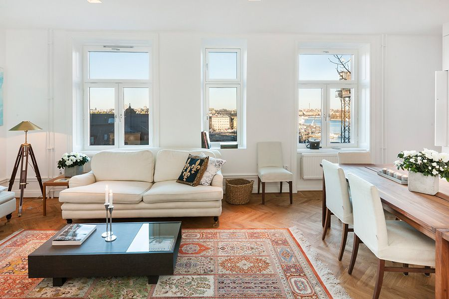 What a view! - and a beautiful classic livingroom with all the whites and a huge traditional Persian carpet