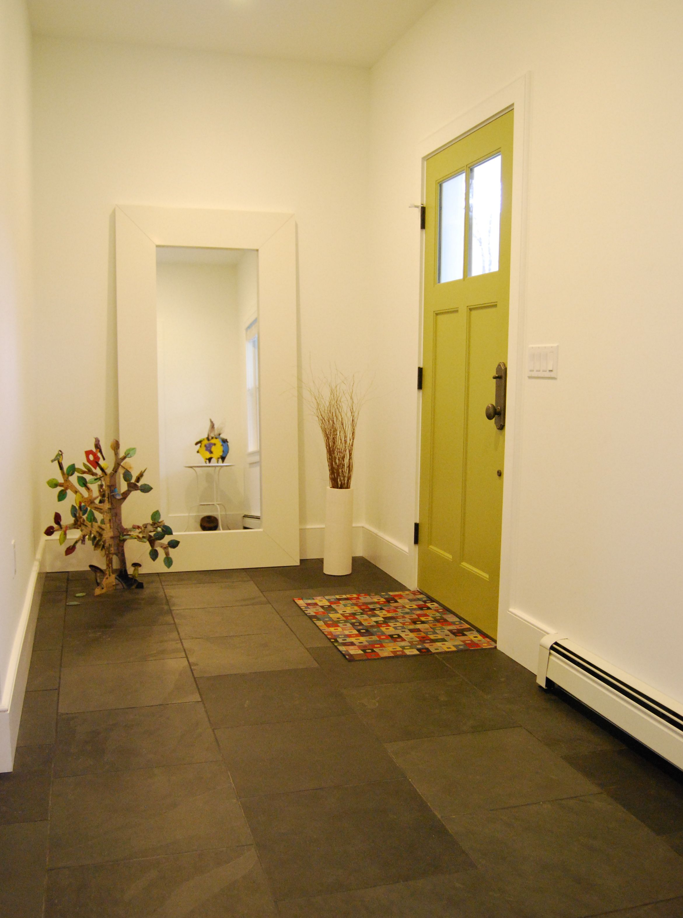 Entry with agave green door and slate floor featured on houzz eclectic foyer with slate floor and bright green door simple bright main entry with 1818 black slate tile floor oversized ikea mirror and whimsical metal dailygadgetfo Image collections
