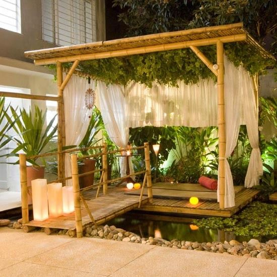 A Garden On The Artificial Pond With Decorative Pergola Of Bamboo