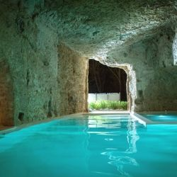 Unique 14th century medieval home set in Italy with an underground cave featuring a pool and Jacuzzi.