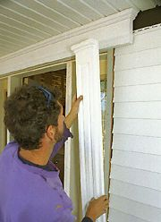 At a front door a furring strip lifts the door trim enough to let