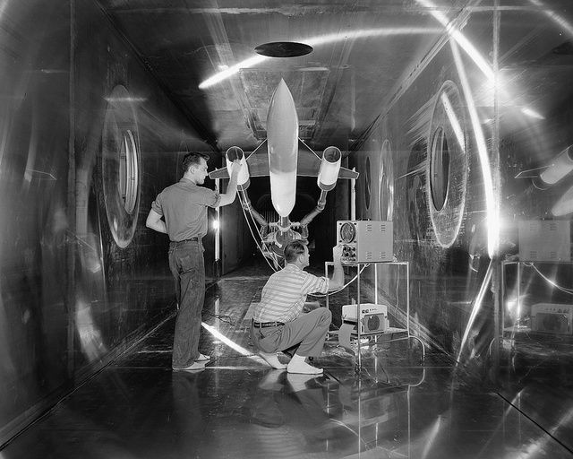 || The superstructures that put us into space — 1957: Engineers inside of the 10x10 Supersonic Wind Tunnel check on a model of a supersonic aircraft.