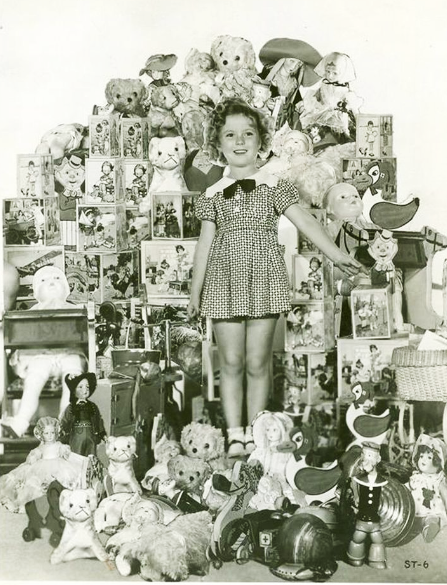 1934 Shirley Temple in a composite photo surrounded by toys and dolls