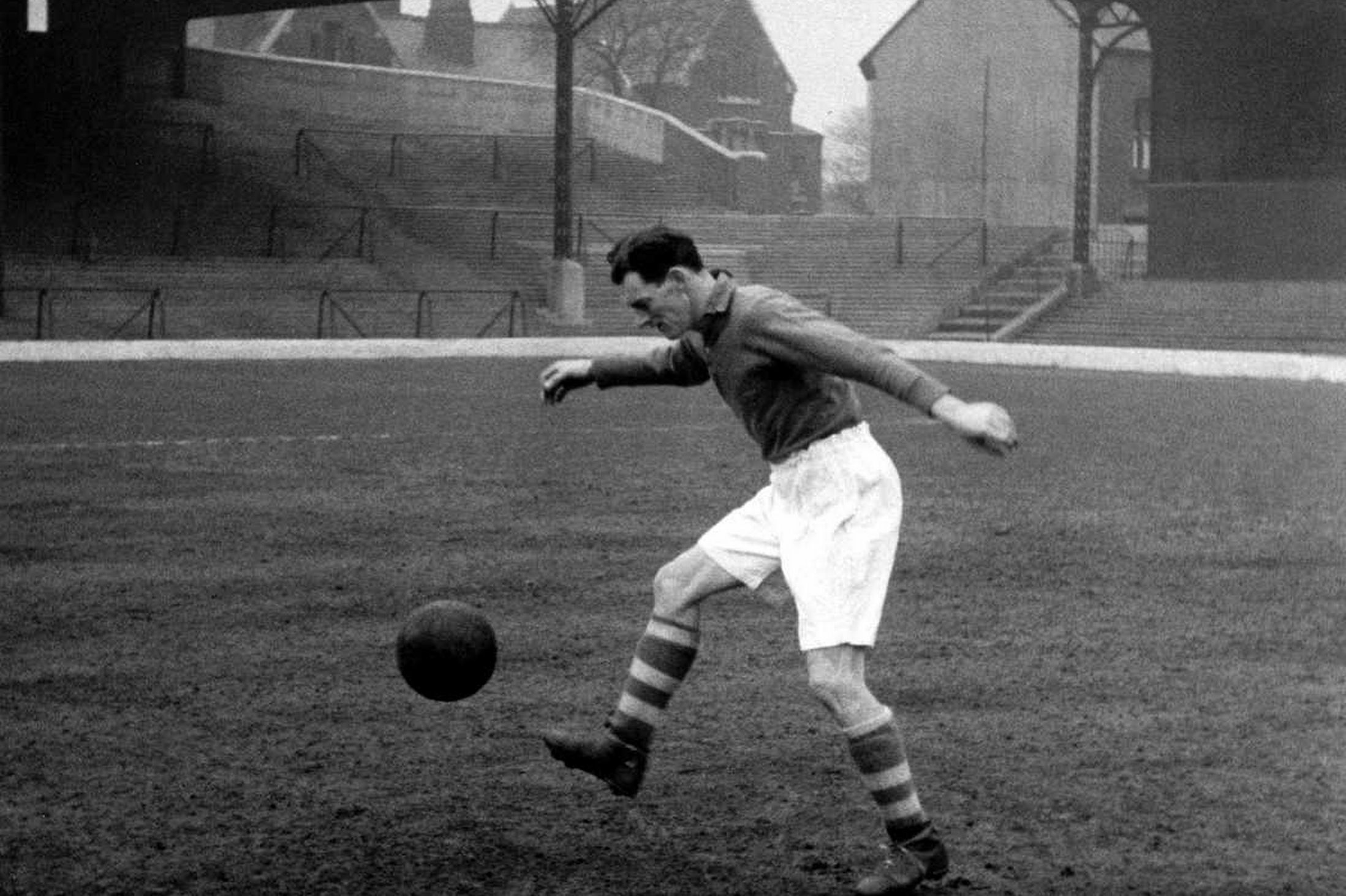 Liverpool footballer Phil Taylor practices his ball control skills during a training session at Anfield. 17th February 1950.