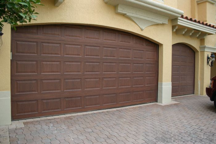 Faux Wood Garage Doors .. Metal Doors Painted To Look Like Real Wood.
