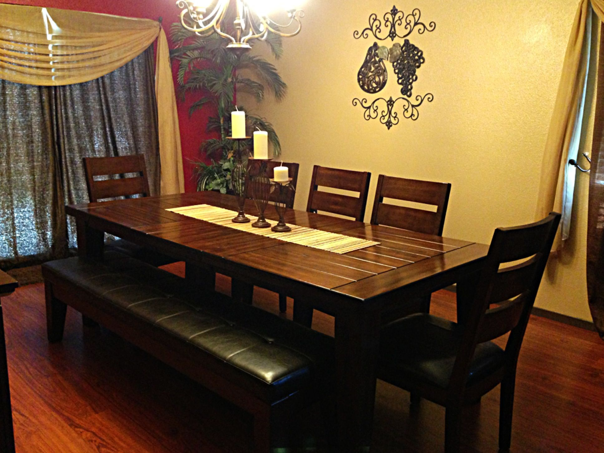 ashley furniture dining table with bench candle holders in the middle and iron decor with brown