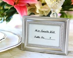 Table number frames. $2.20 http://www.theweddingshoppe.ca/Beautifully_Beaded_Photo_Frame_and_Placeholder_p/ka14013na.htm