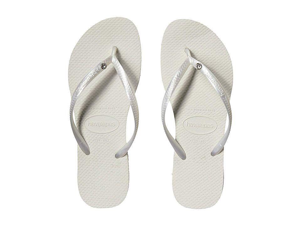 5ba2b57b0 Havaianas Slim Crystal Glamour SW Flip Flops (White Metallic) Women s  Sandals. The Slim Crystal Glamour SW features a sparkling Swarovski  Elements pin ...