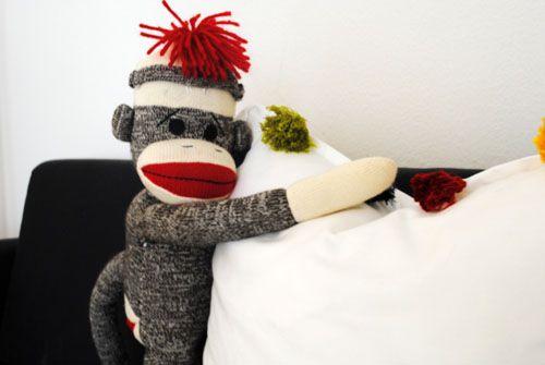 12 - sock monkey loves tassel pillow