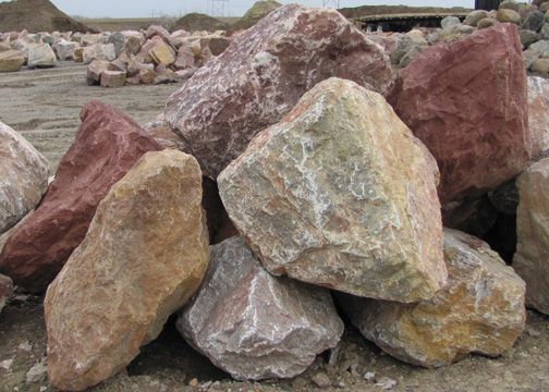 Moonstruck opal boulders landscaping pinterest for Large river stones for landscaping