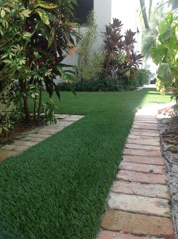 Artificial Grass Installed With Paver Brick Edging On Boca Raton Side Yard Artificial Grass B Artificial Grass Installation Synthetic Lawn Artificial Grass