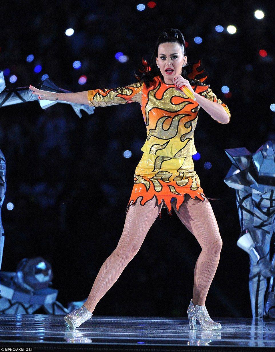 Girl on fire: The star\'s tiny sparkly minidress flattered her frame ...