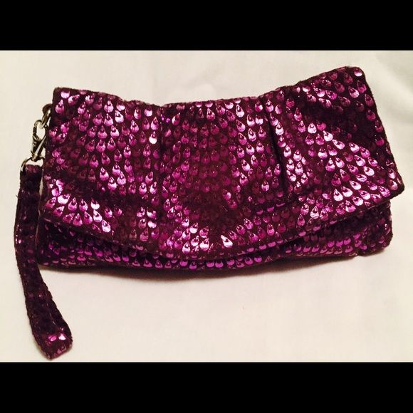 Purple Wristlet This soft, sexy, shiny, roomy and ready-to-go purple/plum wristlet is perfect for a night out. It is in perfect condition. Bags Clutches & Wristlets