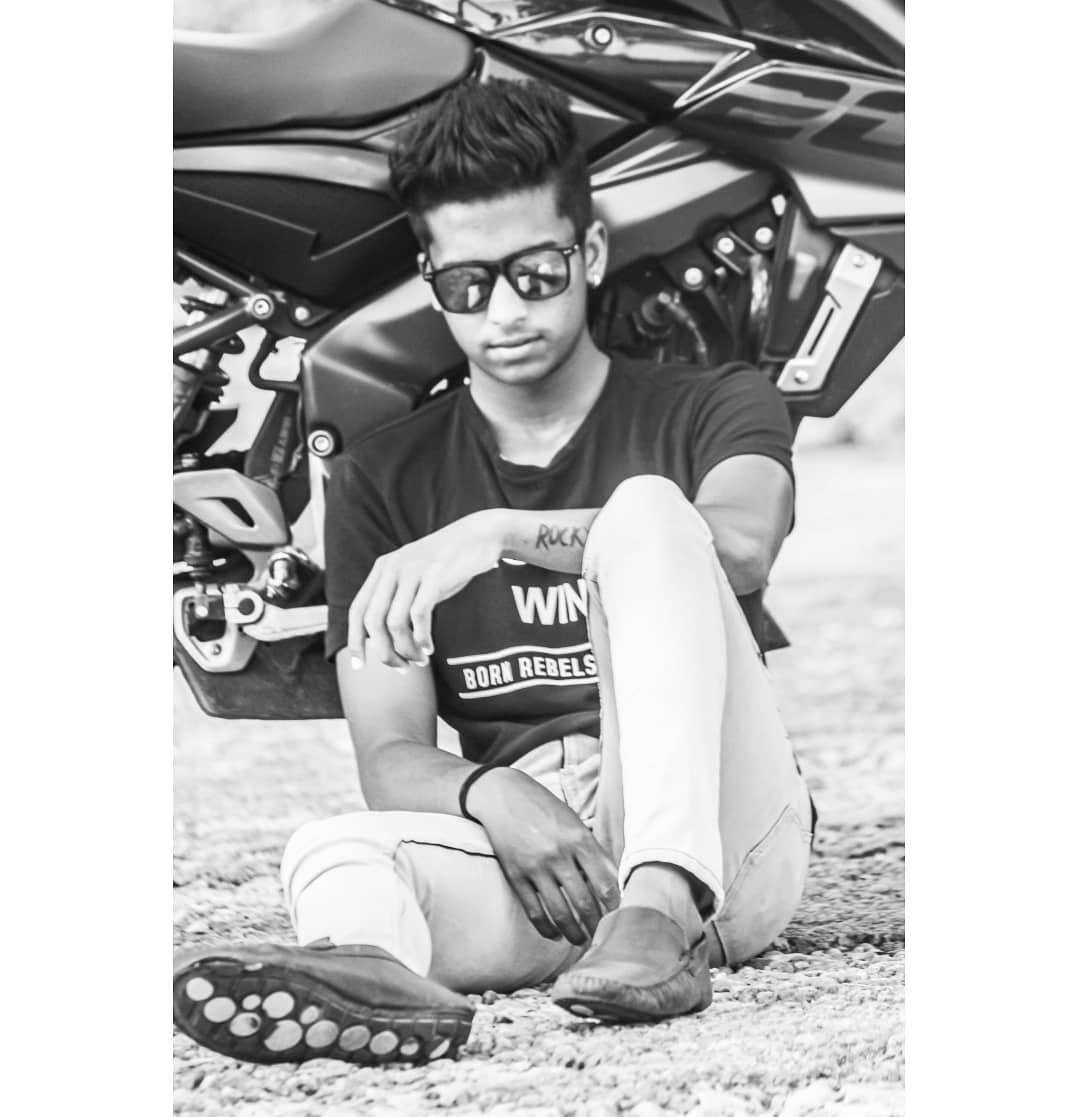 #Mysuru #India #Karnataka #outdoors #fun #young #sitting #fine-looking  #fitness #casual #sunglasses...