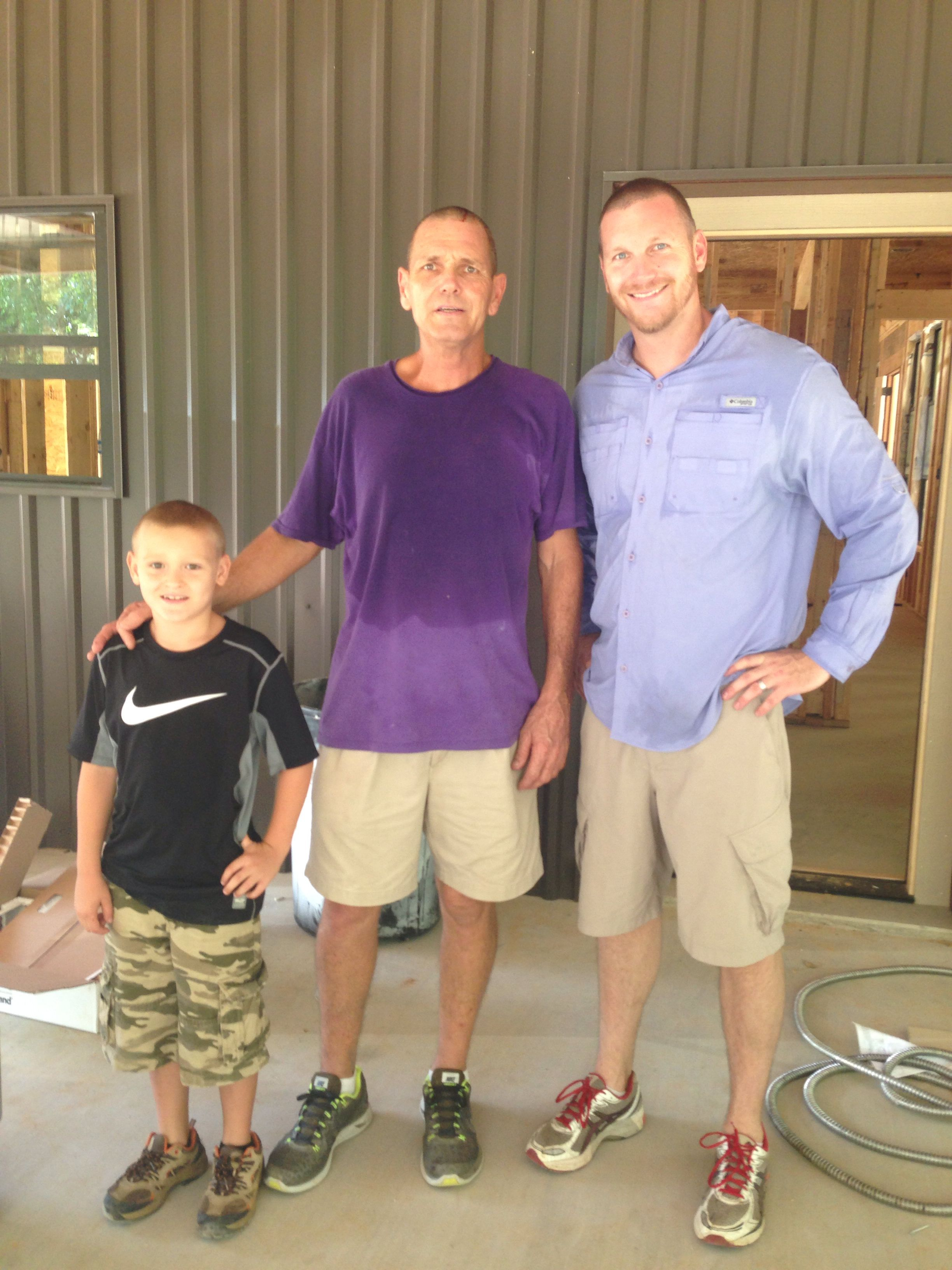 Calem and his daddy with Popps working on the house