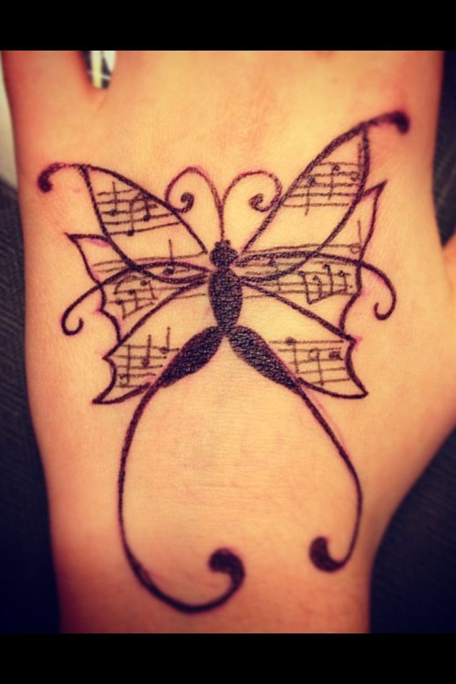 Musical butterfly body art, by: Bailey Nicole