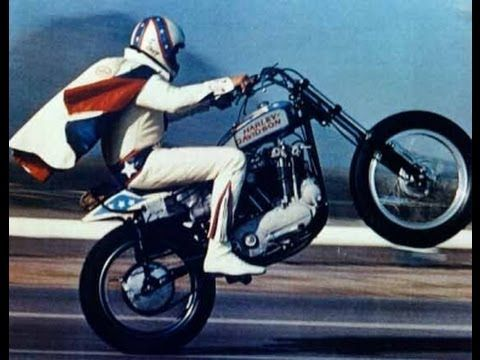 An action-packed biography of one of the world's most famous daredevils, portrayed by George Hamilton. Many of the wild stunts in the film were performed by Evel Knievel himself.    Director: Marvin J. Chomsky