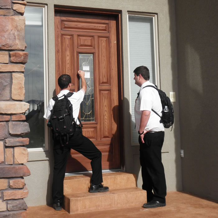 Image result for missionaries knocking door to door