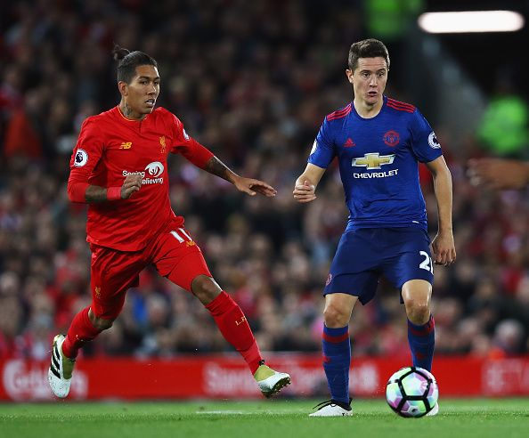 Ander Herrera Of Manchester United Is Closed Down By Roberto Firmino Of Liverp Liverpool Vs Manchester United Manchester United Football Club Manchester United