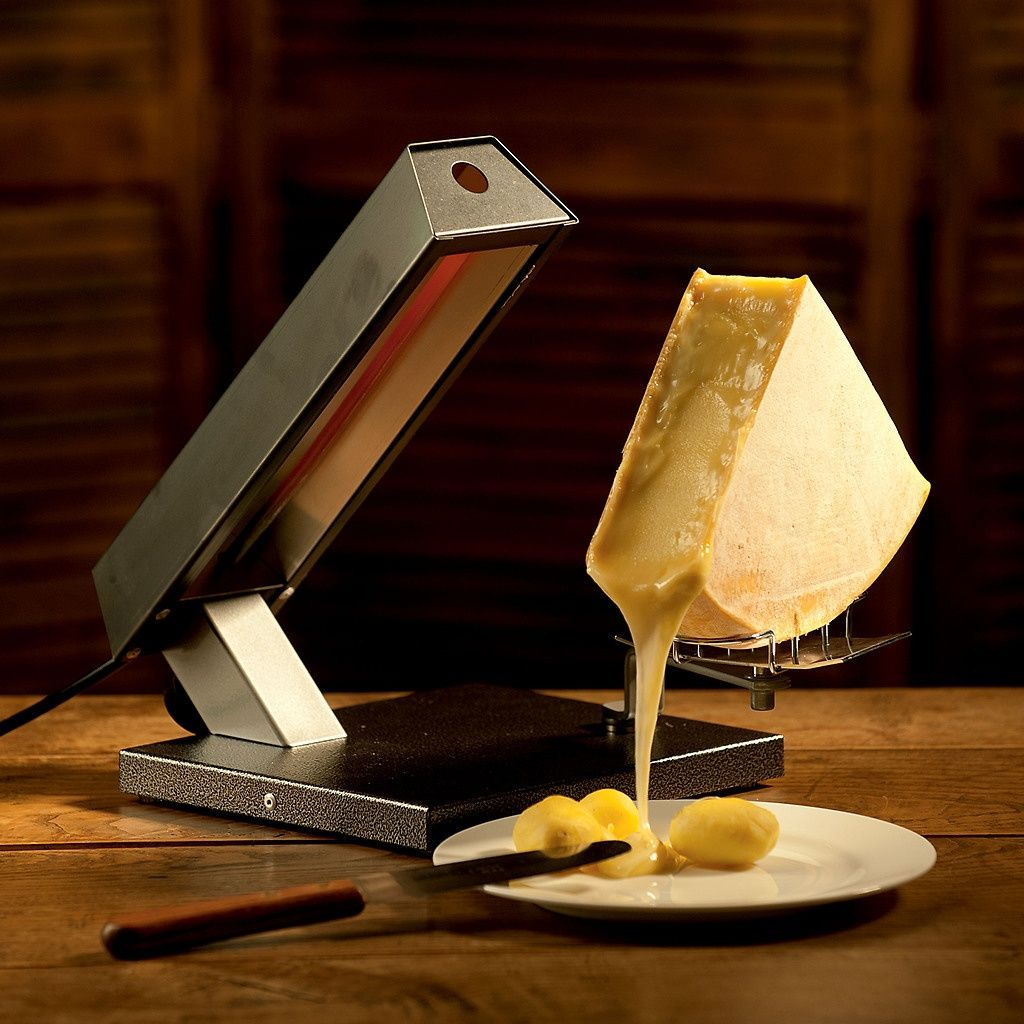 Torquato De raclette machine at torquato de wintage chese troley