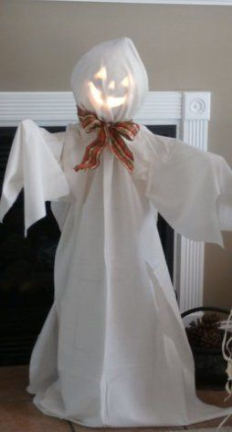 Make a jack-o-lantern ghost tomato cage craft for Halloween home - halloween ghost costume ideas
