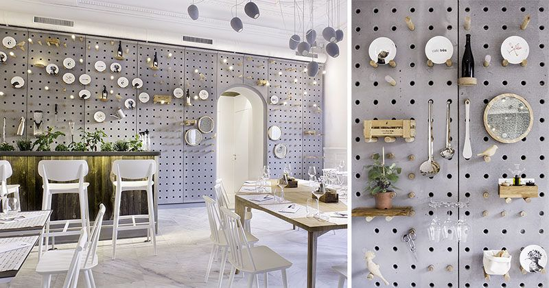 wall decor idea a gray perforated concrete pegboard lines the wall of this cafe for a unique shelving solution